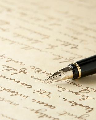 Gold Fountain Pen on Written Page. Crisp