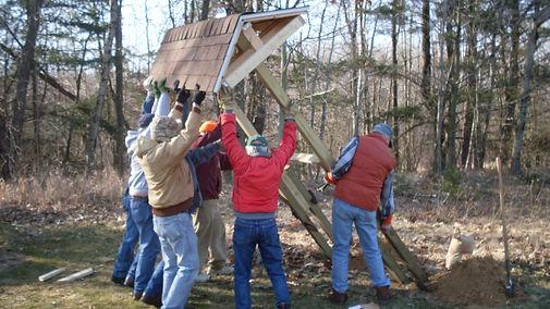 Volunteers raising a kiosk on the FM Heartland Trail
