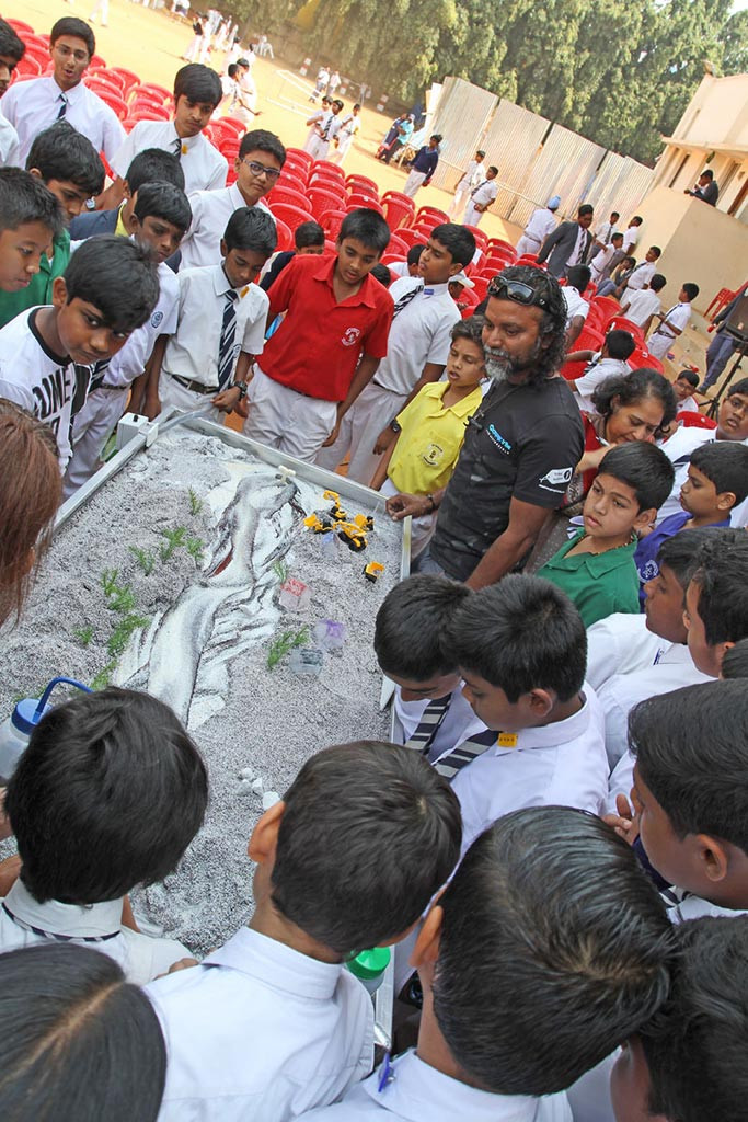 Eager students watch the setup of the Emriver modelling table with Mahseer Trust Trustee, Derek D'Souza