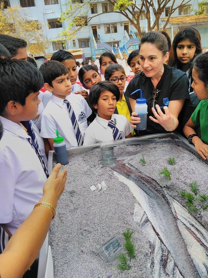 Mahseer Trust volunteer, Claire Pinder, explaining natural river processes to students at The Frank Anthony Public School in Bangalore