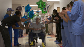 Healthcare workers cheer as COVID patient leaves hospital after 40 days.