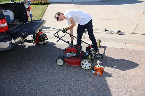 RJ Duarte unfolding a mower on a jobsite