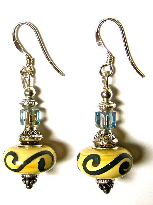 Cream celtic design glass earrings