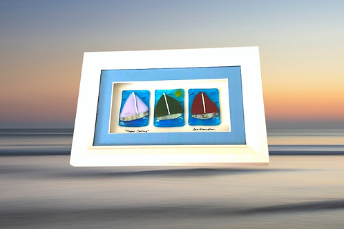 three glass boats framed with glass handmade