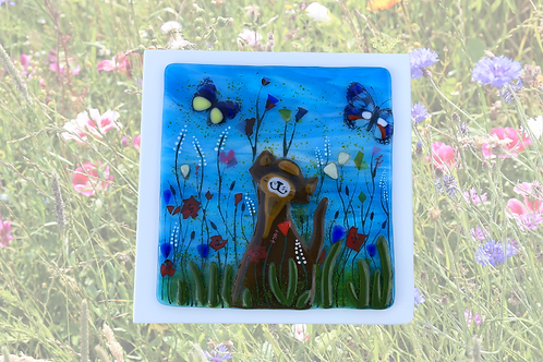 Handmade fused glass cat in meadow of wild flowers