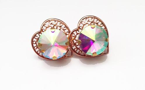 1a9058baa Iridescent Rose Gold Heart Studs. $ 13.00