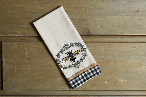 embroidered bee tea towel with black and white check border