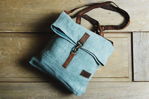 Crossbody handbag with washed blue color and fold over top