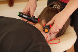 Photopuncture torches applied to a client's head and neck