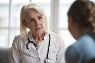 Serious middle-aged female doctor pediat