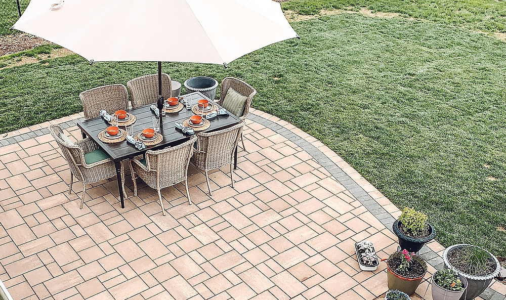Patio inspiration, patio renovation, patio makeover, outdoor décor, outdoor living spaces, paver patio ideas, paver patio, hardscape inspiration, newline paver patio, dark inlay border patio, home styling blog, outdoor living, hampden bay patio furniture, home depot patio furniture, abba patio umbrella, wheat straw tableware, dining patio styling, outdoor tableware, outdoor planters, diy planter pots, farmhouse outdoor style, dining patio, conversation patio set, outdoor furniture, outdoor spaces, random pattern paver patio, outdoor styling, neutral color palette patio, concrete patio renovation, the rural legend, beautiful outdoor spaces, back yard inspiration, backyard retreat, patio retreat, SML outdoor living experts