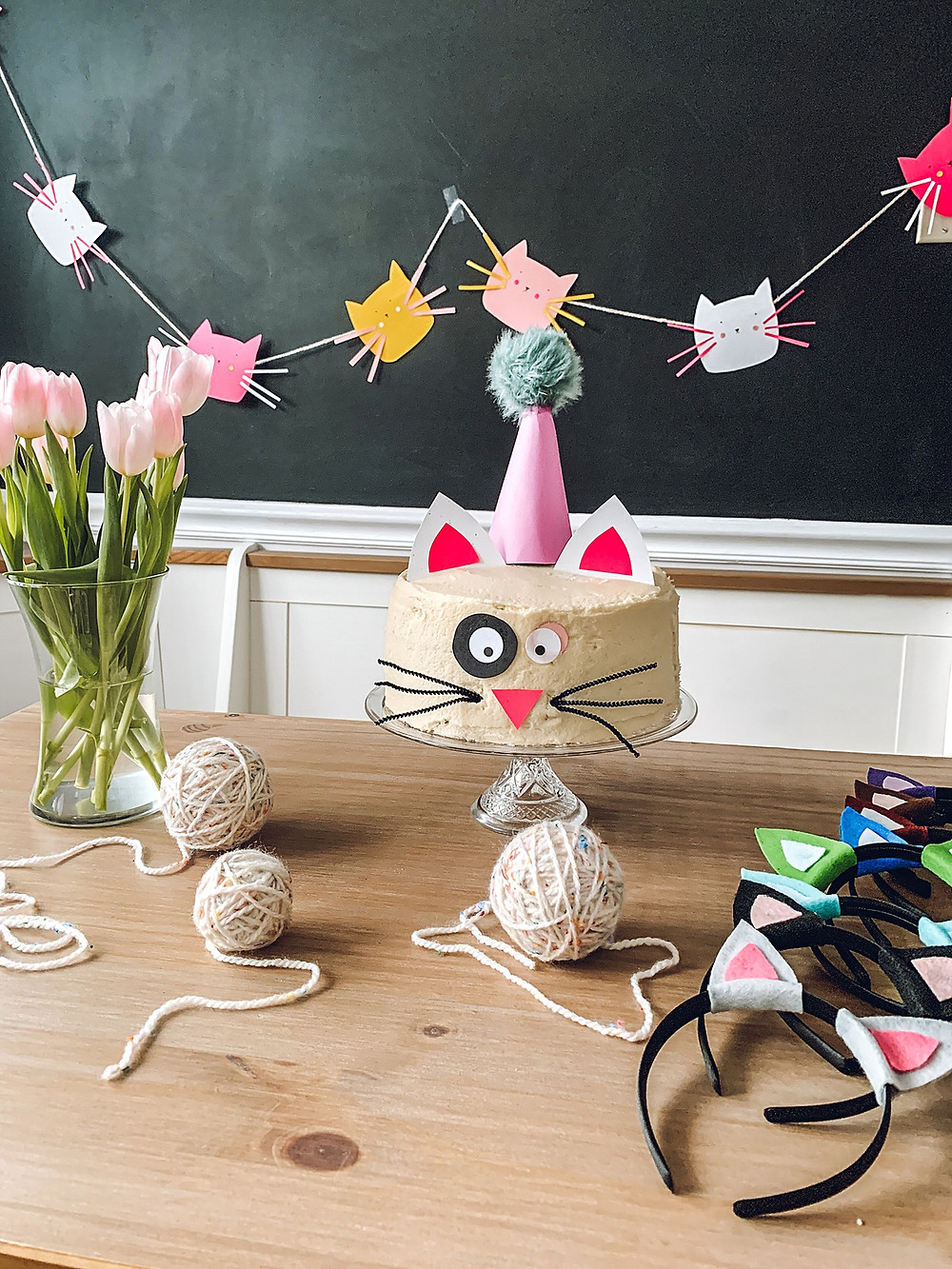 diy party ideas, diy cake cake, diy cake decorations, diy animal ear costume, diy costume, diy cat garland, diy garland, diy party, chocolate cake recipe, best chocolate cake recipe, bakery cake from a box mix, homemade chocolate whipped cream recipe, kids birthday party ideas, girls birthday party, boys birthday party, cat lover party, cat birthday party, diy cat crafts, easy diy party decorations, easy diy ideas, cheap diy ideas, cheap diy party decorations, cake decorating diy, yarn crafts, 2 year old party, 2 year old party theme