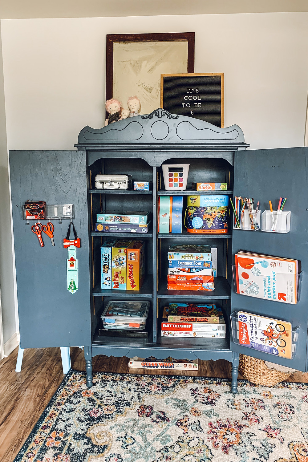 Playroom makeover, playroom storage ideas, antique armoire, refinishing antique furniture, armoire makeover, new uses for armoire, toy storage, lego storage ideas, playroom design, playroom inspiration, playroom styling, art station ideas, storage ideas for toys, kid spaces, kid play space inspiration, best kids toys, educational kids toys, how to refinish antique furniture, how to refinish veneer furniture, armoire transformation, diy home improvement ideas, easy diy home improvement, kid friendly spaces, kid friendly storage
