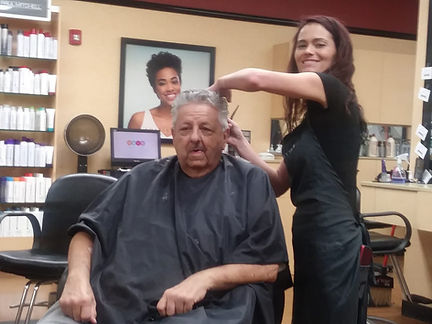 Tim getting his haircut by Kendra.jpg