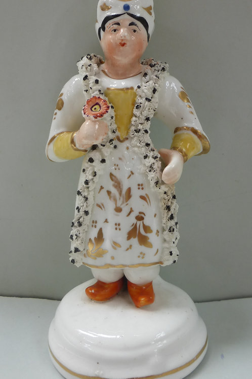 19THC STAFFORDSHIRE FIGURE OF A LADY HOLDING A FLOWER