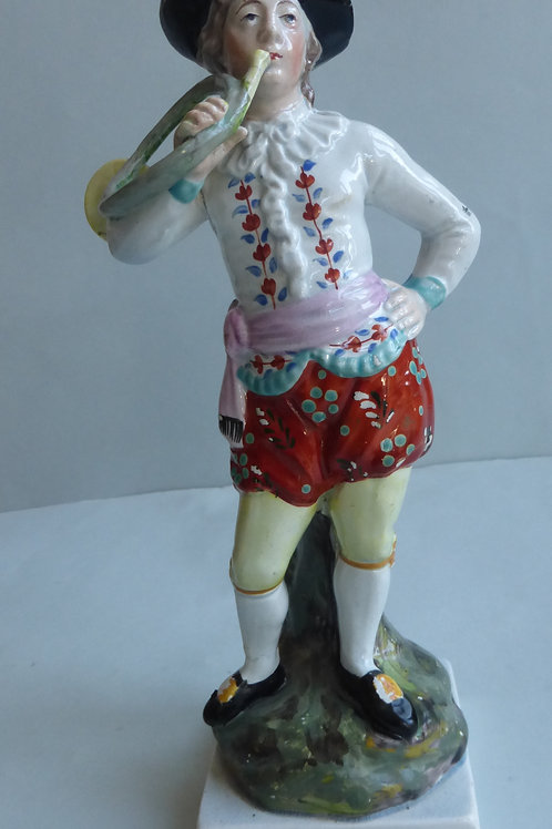 19THC STAFFORDSHIRE PEARLWARE GROUP OF A MUSICIAN