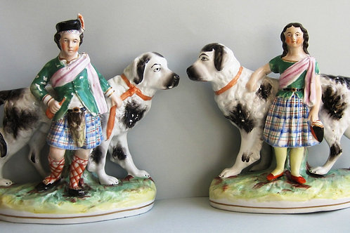 VERY PAIR 19THC STAFFORDSHIRE NEWFOUNDERLAND DOGS WITH CHILDREN