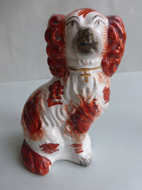 SMALL 19TH CENTURY STAFFORDSHIRE RED AND WHITE SPANIEL