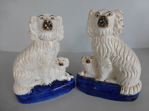 PAIR 19THC. STAFFORDSHIRE SPANIELS WITH PUPS