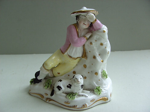 19THC PORCELLANOUS STAFFORDSHIRE BOY AND DOG