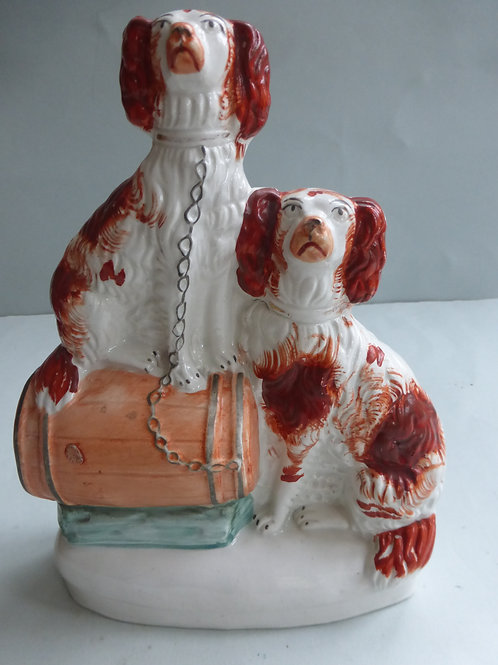 19TH CENTURY STAFFORDSHIRE GROUP OF 2 SPANIELS SEATED ON BARRELL