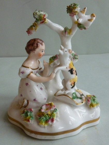 19THC STAFFORDSHIRE PORCELLANOUS GROUP OF GIRL WITH A CAT