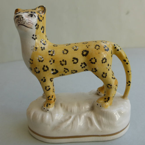 19THC STAFFORDSHIRE PORCELLANOUS GROUP OF A STANDING LEOPARD