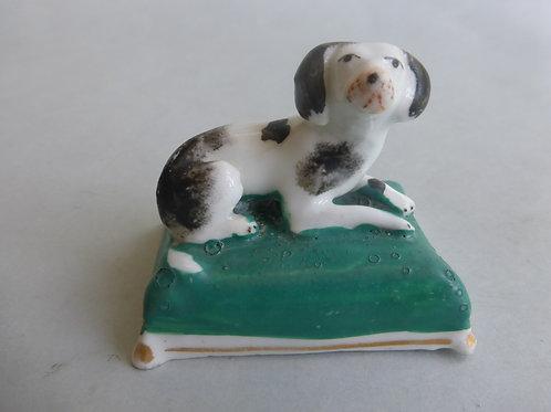 19thc. Porcellanous Staffordshire Spaniel on green cushion base Ref # 4338