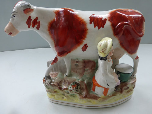 19THC. STAFFORDSHIRE COW GROUP WITH BOY