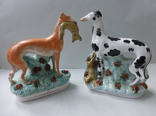 SUPERB MATCHED PAIR OF 19THC. STAFFORDSHIRE GREYHOUNDS