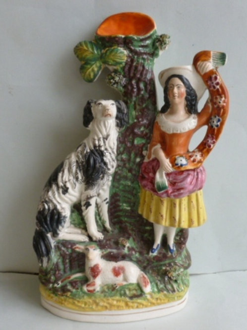 19THC. STAFFORDSHIRE SPILL VASE GIRL AND DOG