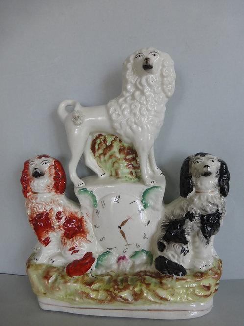 19THC. STAFFORDSHIRE 3 DOG CLOCK GROUP
