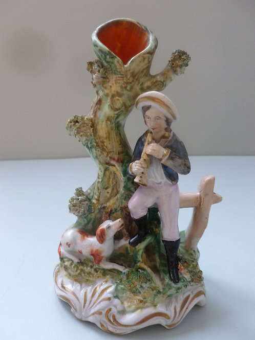 19THC. STAFFORDSHIRE SPILL VASE OF BOY AND DOG