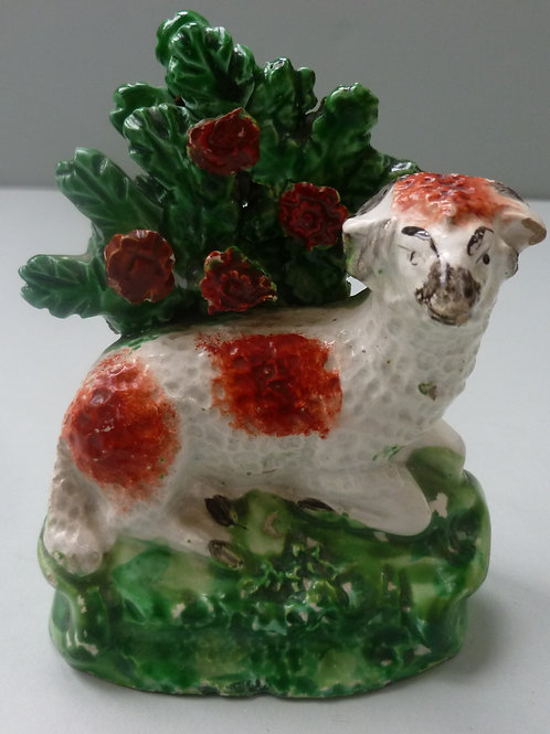 19THC PEARLWARE  STAFFORDSHIRE  OF RECLINING SHEEP