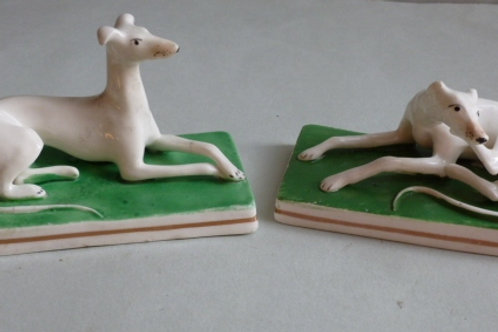PAIR 19THC PORCELLANOUS STAFFORDSHIRE GREYHOUNDS