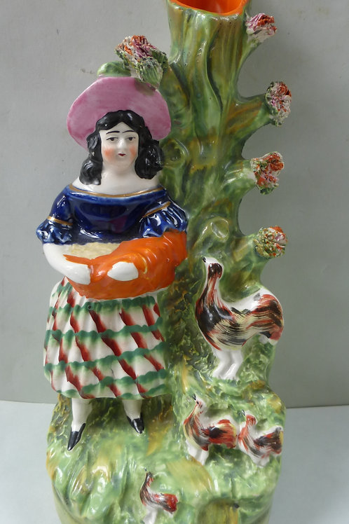 19TH CENTURY STAFFORDSHIRE SPILL VASE OF GIRL WITH COCKEREL