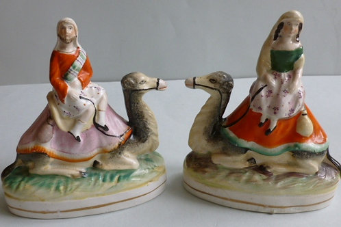 RARE PAIR 19THC STAFFORDSHIRE OF SIR RICHARD BURTON AND LADY BURTON ON CAMELS