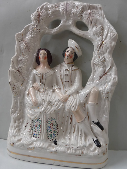 LARGE 19TH CENTURY STAFFORDSHIRE OF TWO LOVERS UNDER AN ARBOUR