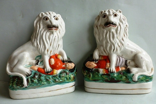 PAIR 19THC STAFFORDSHIRE FIGURES OF BRITISH LION WITH LOUIS NAPOLEON