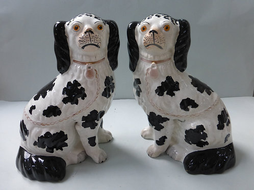PAIR 19THC. STAFFORDSHIRE DISTRAILI DOGS WITH CURLS