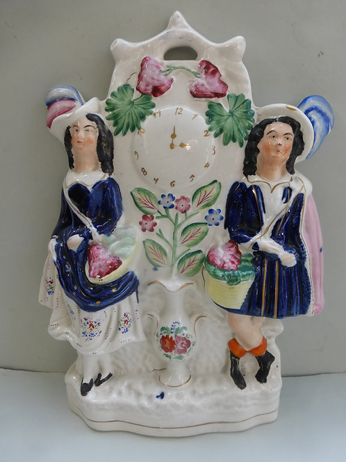 19TH CENTURY STAFFORDSHIRE CLOCK GROUP