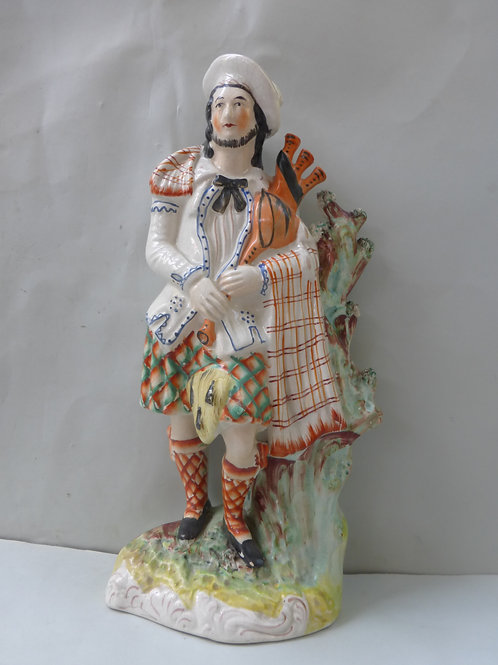 SUPERB 19THC STAFFORDSHIRE SCOTSMAN WITH BAGPIPES