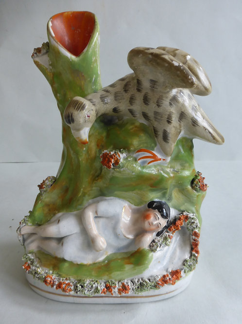 19TH CENTURY STAFFORDSHIRE SPILL HOLDER OF EAGLE AND CHILD