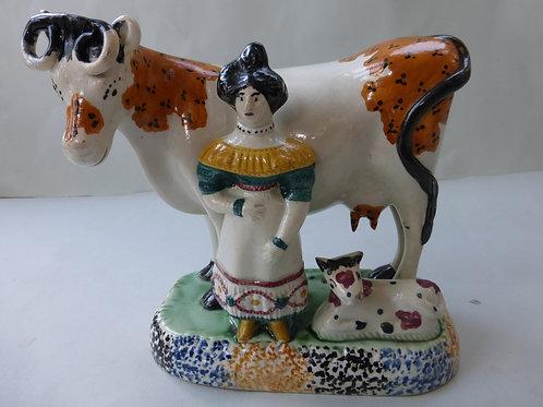 EARLY 19THC. STAFFORDSHIRE PRATTWARE COW CREAMER