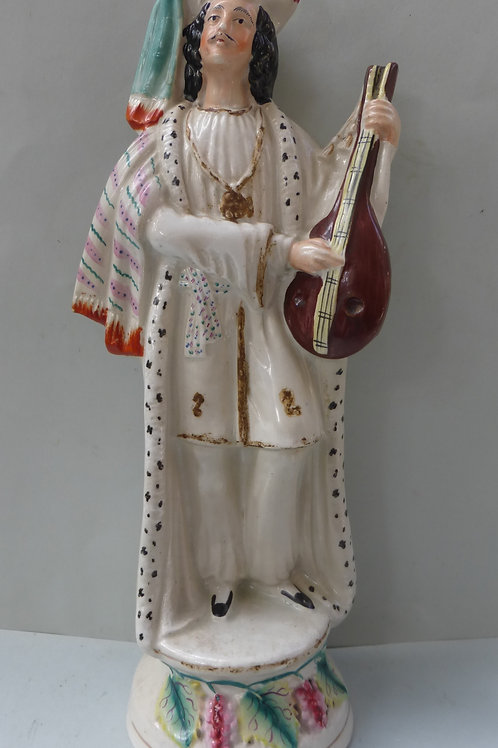 19TH CENTURY STAFFORDSHIRE FIGURE OF A MUSICIAN