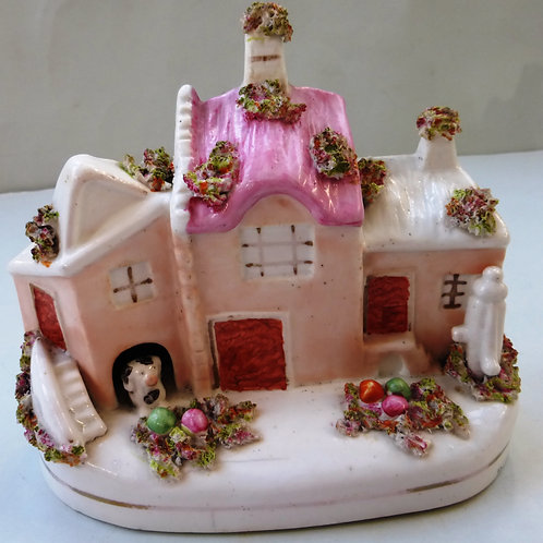 19THC. STAFFORDSHIRE PORCELLANOUS COTTAGE WITH DOG