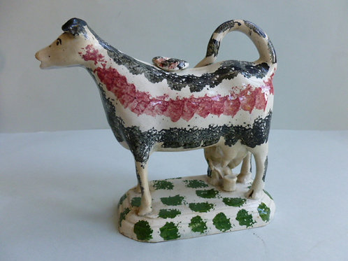 EARLY 19THC STAFFORDSHIRE PEARLWARE COW CREAMER WITH MILKMAID