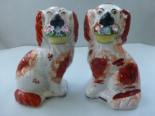 MATCHED PAIR STAFFORDSHIRE 19THC. DOGS WITH FLOWER BASKETS