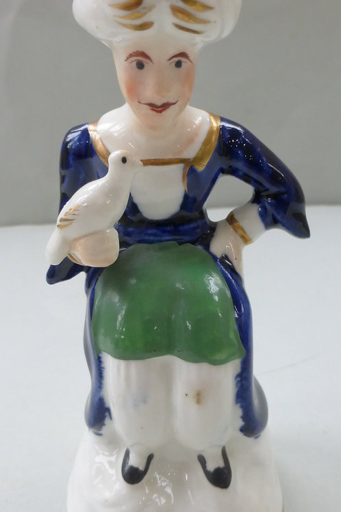 19TH CENTURY STAFFORDSHIRE PORCELLANOUS FIGURE OF A TURK