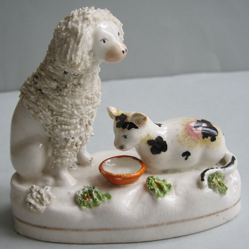 19THC STAFFORDSHIRE POODLE AND CAT